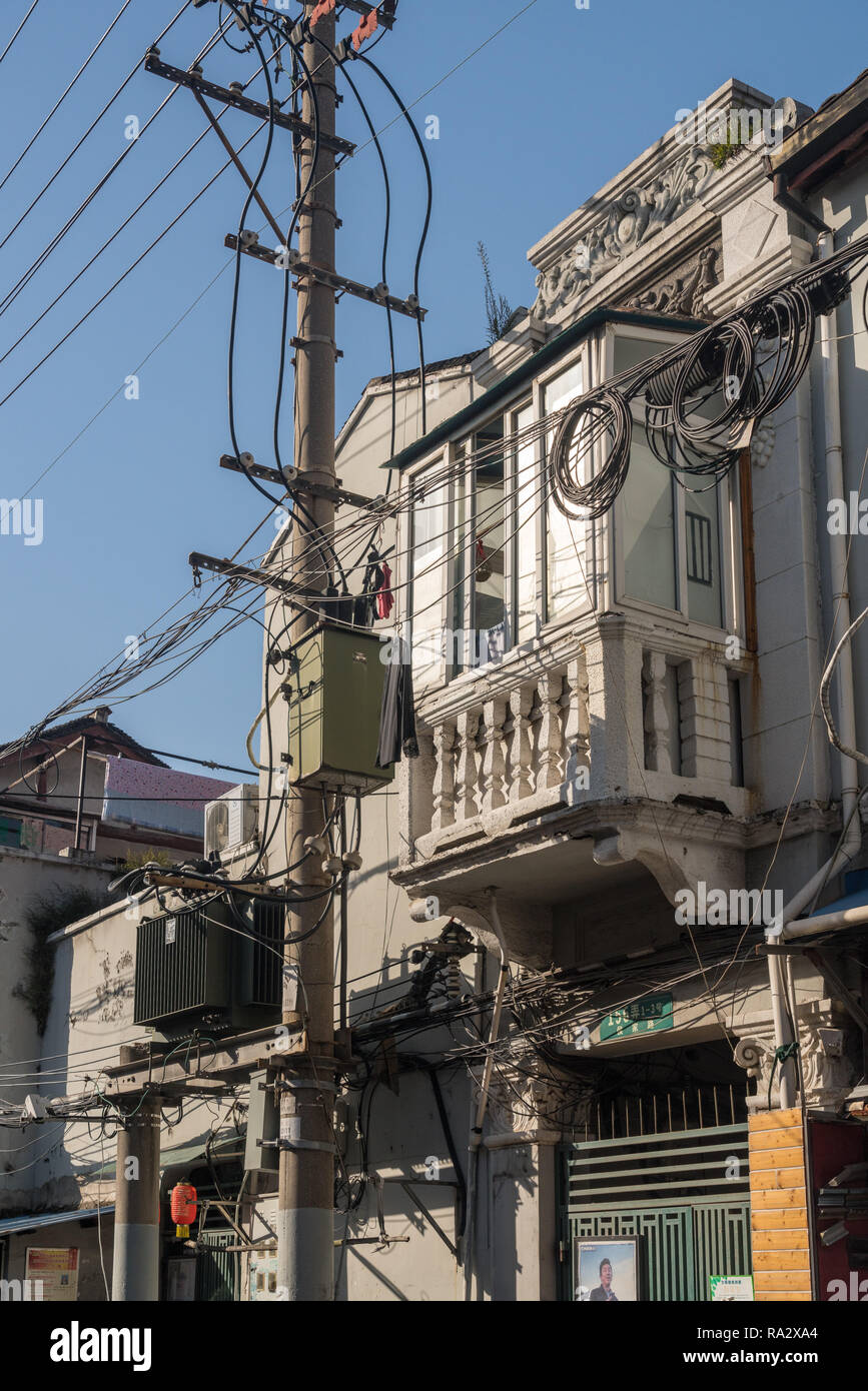 Electric and telephone cabling on poles in Shanghai China - Stock Image
