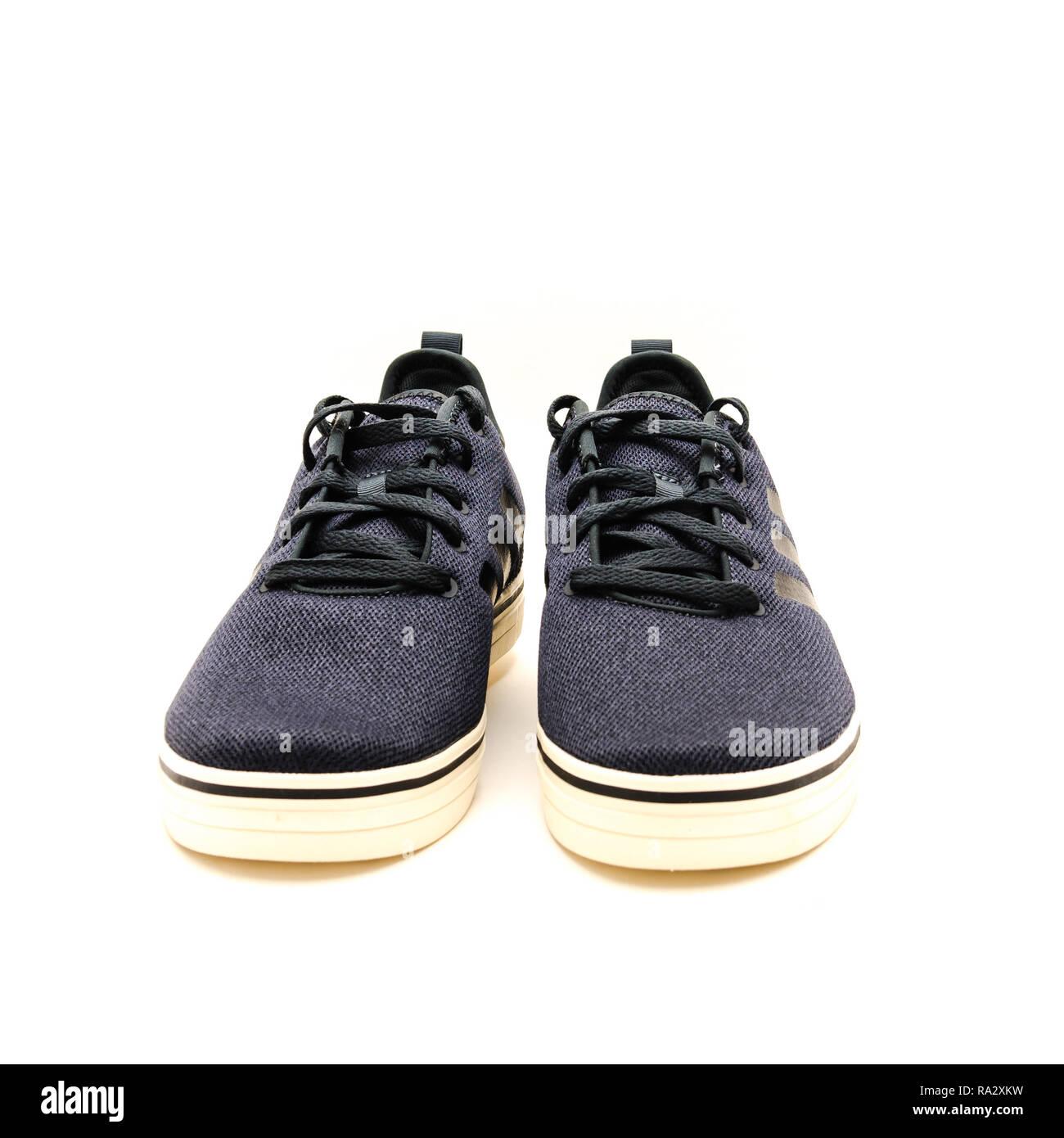 Brand new pair of dark gray men sneaker shoes isolated Stock Photo
