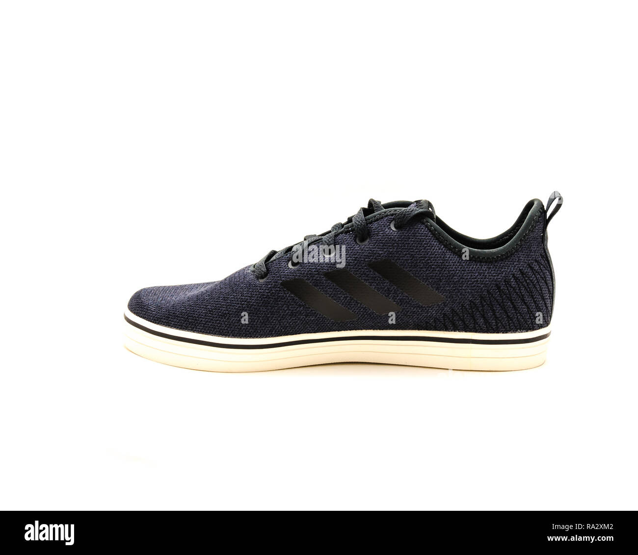 Studio shot brand new dark gray men sneaker shoes isolated Stock Photo