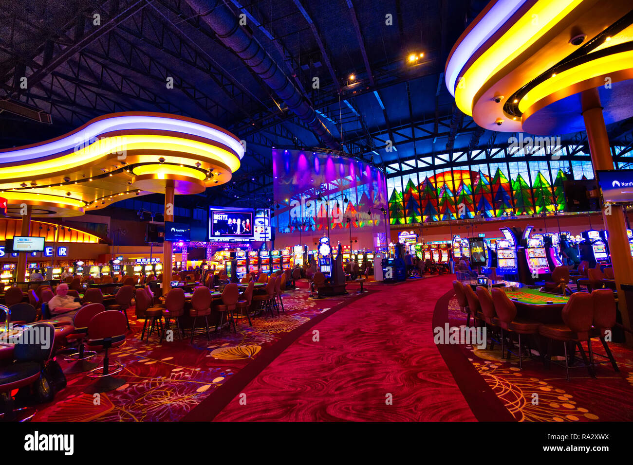 Buffalo, USA-20 July, 2018: Modern casino hall with slot machines, roulette and blackjack tables Stock Photo
