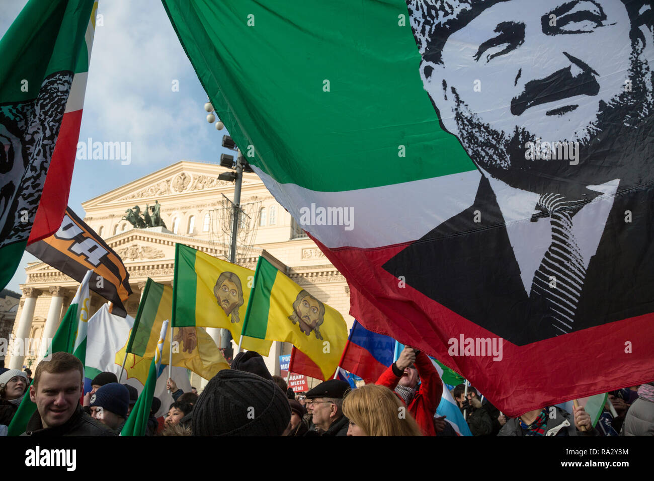 Participants of the March movement 'Anti-Maidan' holding a flag of the Chechen Republic with a portrait of Akhmat Kadyrov in center of Moscow - Stock Image