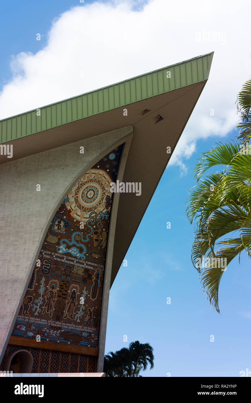The exterior of the National Parliament of Papua New Guinea showing traditional motifs. - Stock Image