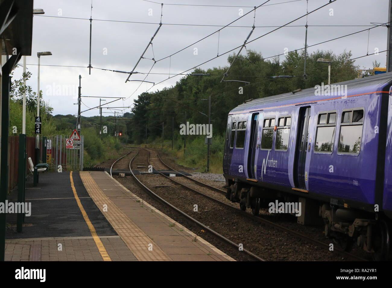 A Northern Rail class 319 EMU at Euxton Balshaw Lane heading northbound to Preston. - Stock Image