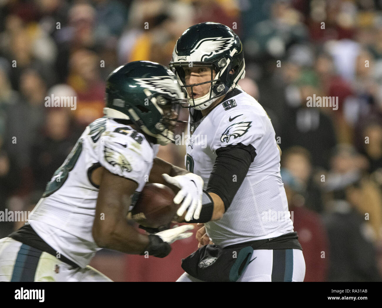 Landover, Maryland, USA. 30th Dec, 2018. Philadelphia Eagles quarterback Nick Foles (9) hands-off to running back Wendell Smallwood (28) in fourth quarter action against the Washington Redskins at FedEx Field in Landover, Maryland on December 30, 2018. The Eagles won the game 24 - 0 and their victory coupled with the Viking loss allowed them to advance to the NFC playoffs Credit: Ron Sachs/CNP/ZUMA Wire/Alamy Live News - Stock Image