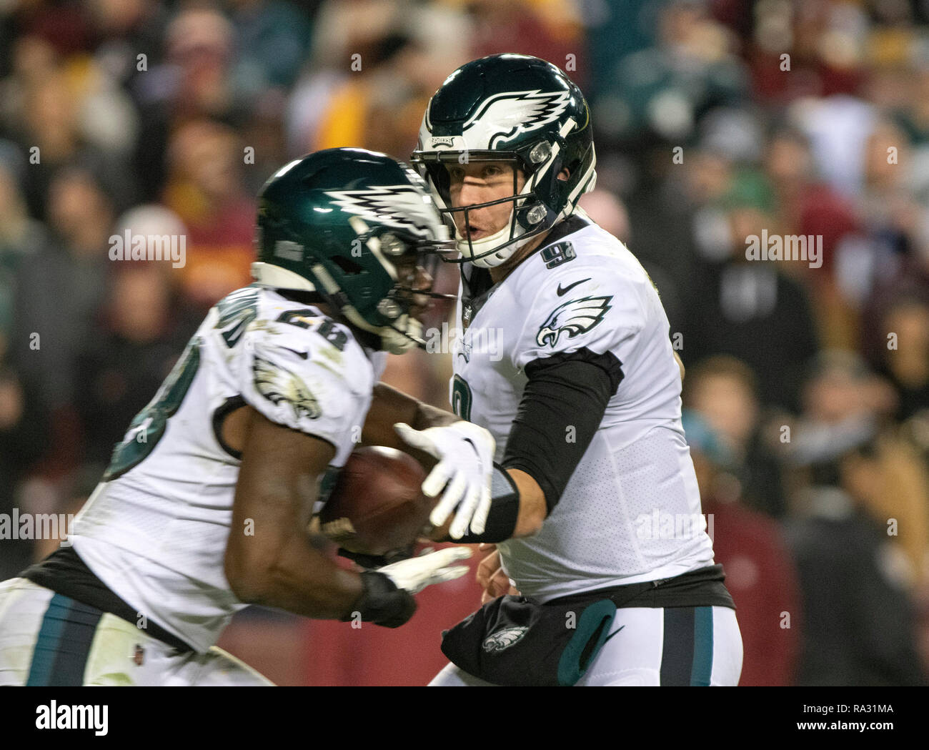Philadelphia Eagles quarterback Nick Foles (9) hands-off to running back Wendell Smallwood (28) in fourth quarter action against the Washington Redskins at FedEx Field in Landover, Maryland on December 30, 2018. The Eagles won the game 24 - 0 and their victory coupled with the Viking loss allowed them to advance to the NFC playoffs. Credit: Ron Sachs/CNP | usage worldwide - Stock Image