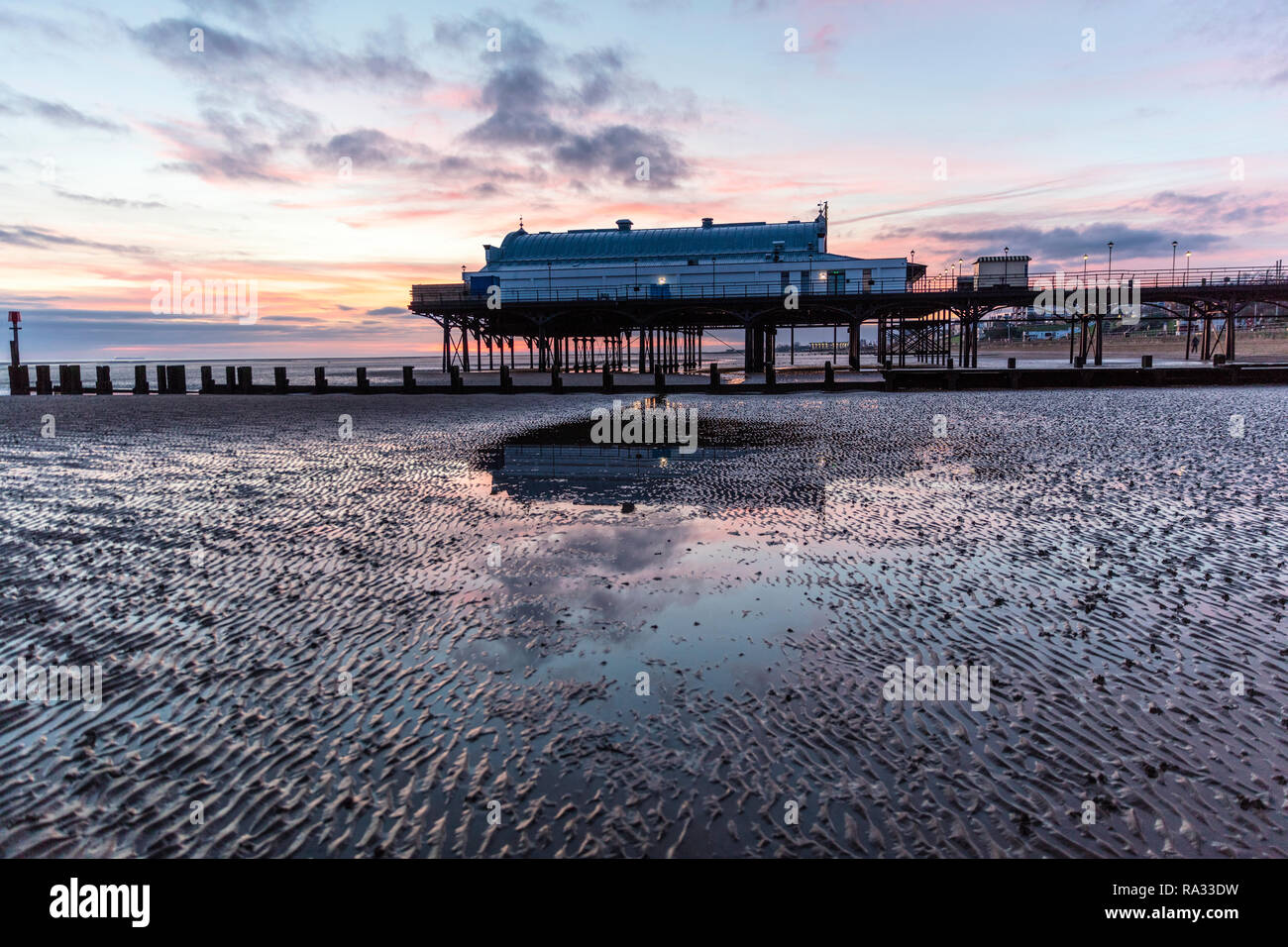 Cleethorpes, Lincolnshire, UK. 31st Dec, 2018. UK Weather: Red sunrise skies in Cleethorpes, Lincolnshire, East Coast, UK. 31st Dec, 2018. Red sky making the perfect backdrop to Cleethorpes Pier with partial cloud. Credit: Tommy (Louth)/Alamy Live News - Stock Image