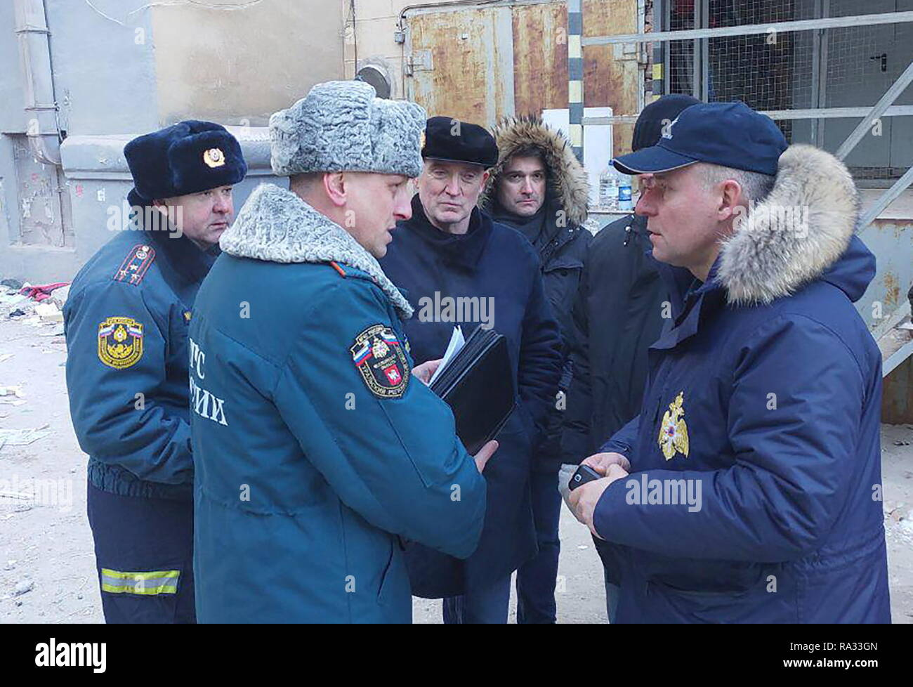Mgnitogorsk, Russia. 31st Dec, 2018. MAGNITOGORSK, RUSSIA - DECEMBER 31, 2018: Chelyabinsk Region Governor Boris Dubrovsky (C background) and Russia's Emergency Situations Minister Yevgeny Zinichev (R) at the site of an apartment building collapse. A domestic gas blast caused a partial collapse of a residential building at 164 Karla Marksa Prospekt Street killing four people. Chelyabinsk Region Governor Press Office/TASS Credit: ITAR-TASS News Agency/Alamy Live News - Stock Image