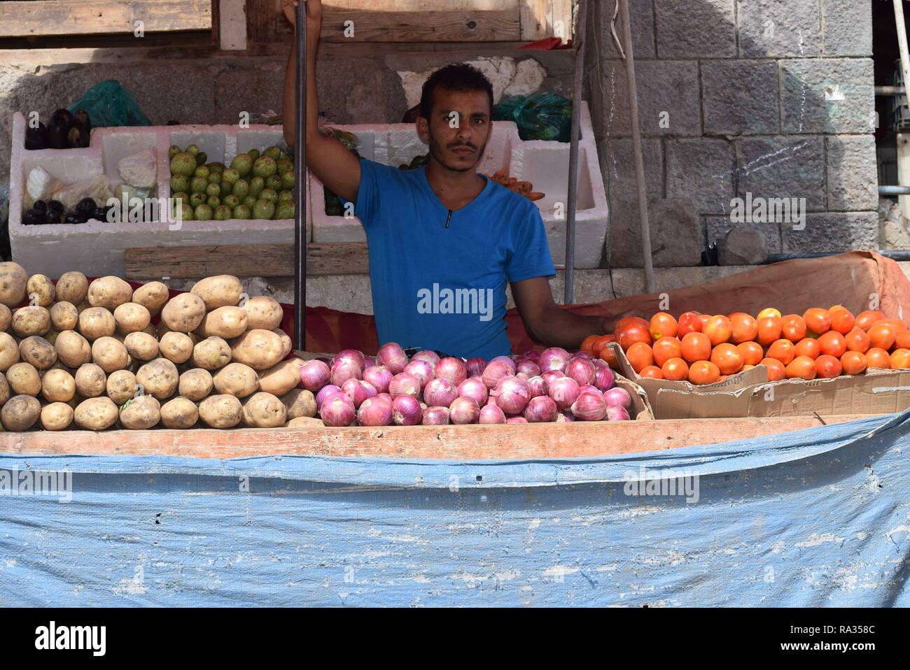 Aden, Yemen. 31st Dec, 2018. An owner of a vegetable store waits for customers near a market in the southern port city of Aden, Yemen, Dec. 31, 2018. In 2018, Yemen experienced dramatic escalation of the internal military conflict, severe collapse of the country's national currency and an outbreak of acute diseases. Yemeni people also suffered skyrocketing prices of basic commodities and lack of basic services, including clean water and electricity. TO GO WITH Spotlight: Yemenis to receive new year amid hard challenges, devastating civil war Credit: Murad Abdo/Xinhua/Alamy Live News - Stock Image
