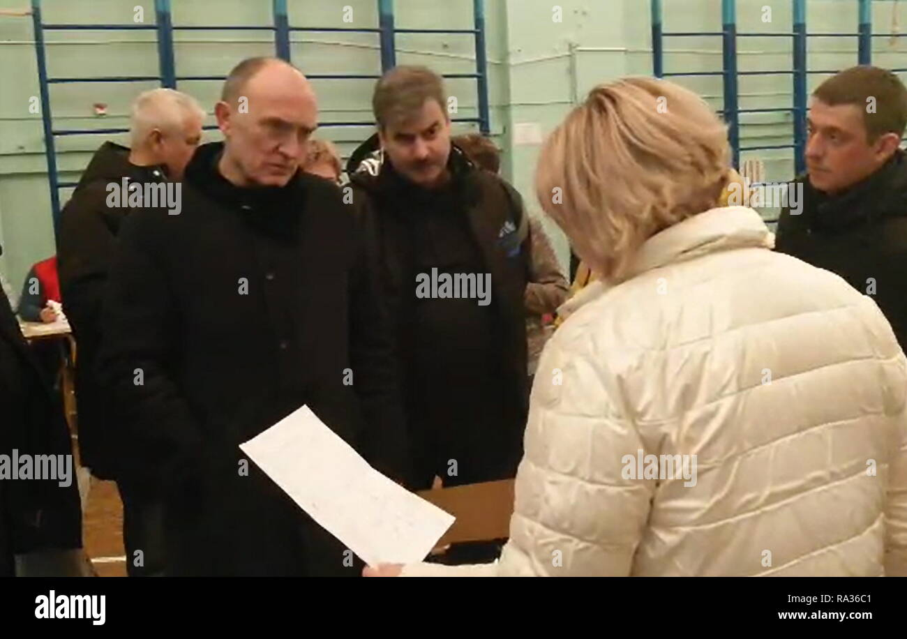 Magnitogorsk, Russia. 31st Dec, 2018. Magnitogorsk, Russia. 31st Dec, 2018. Chelyabinsk Region Governor Boris Dubrovsky (L) in a school temporarily housing the victims of an apartment building collapse in the city of Magnitogorsk. A domestic gas blast has caused a partial collapse of a residential building at 164 Karla Marksa Avenue; 4 people have been killed, dozens remain missing. The Chelyabinsk Region Branch of the Russian Emergencies Ministry/TASS Credit: ITAR-TASS News Agency/Alamy Live News - Stock Image