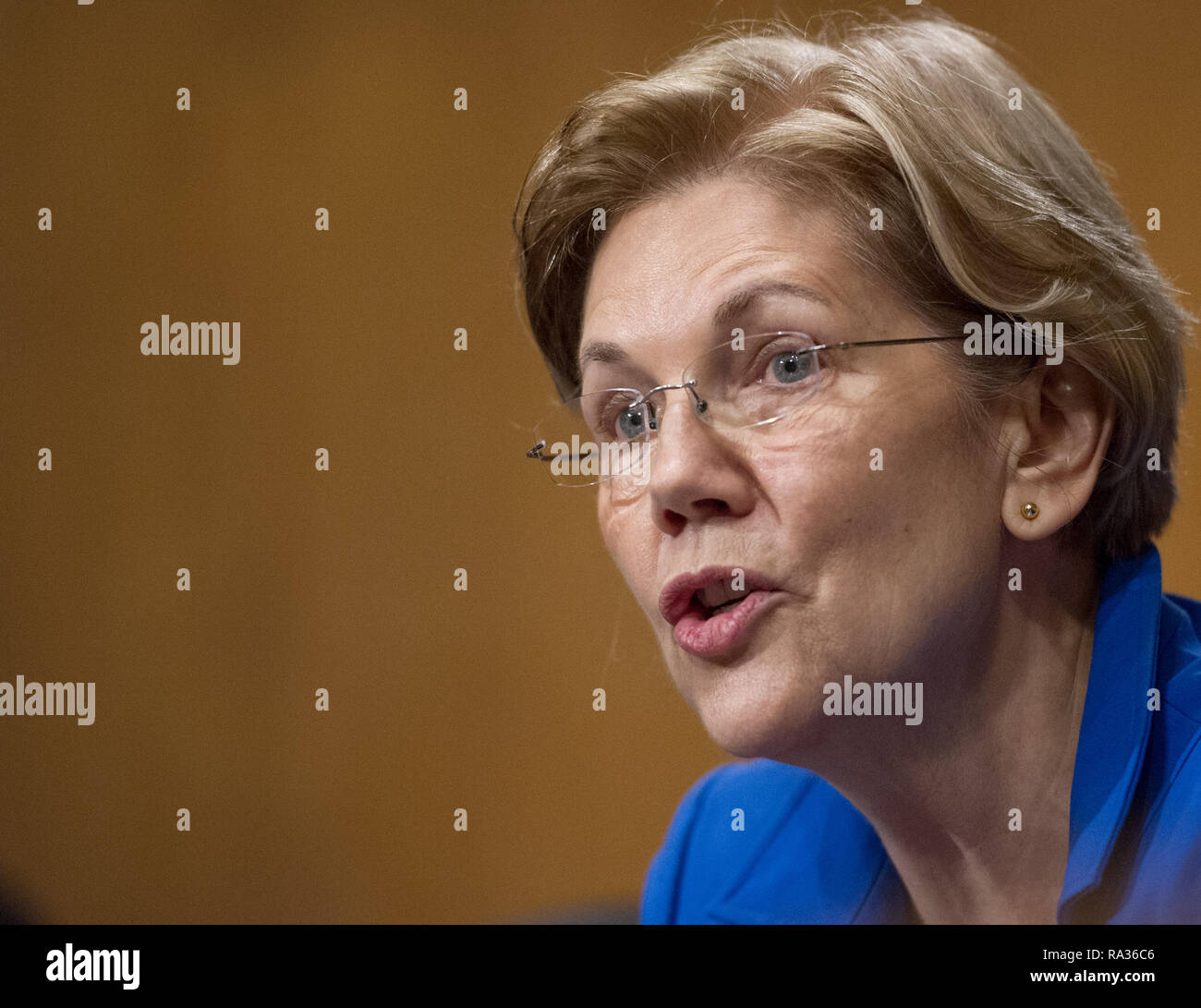 January 23, 2018 - Washington, District of Columbia, United States of America - United States Senator Elizabeth Warren (Democrat of Massachusetts) asks questions during testimony before the US Senate Committee on Banking, Housing, and Urban Affairs during the confirmation hearing for Jelena McWilliams, to be Chairperson and a Member of the Board of Directors of the Federal Deposit Insurance Corporation; Dr. Marvin Goodfriend, to be a Member of the Board of Governors of the Federal Reserve System; and Mr. Thomas E. Workman, to be a Member of the Financial Stability Oversight Council, on Capitol Stock Photo