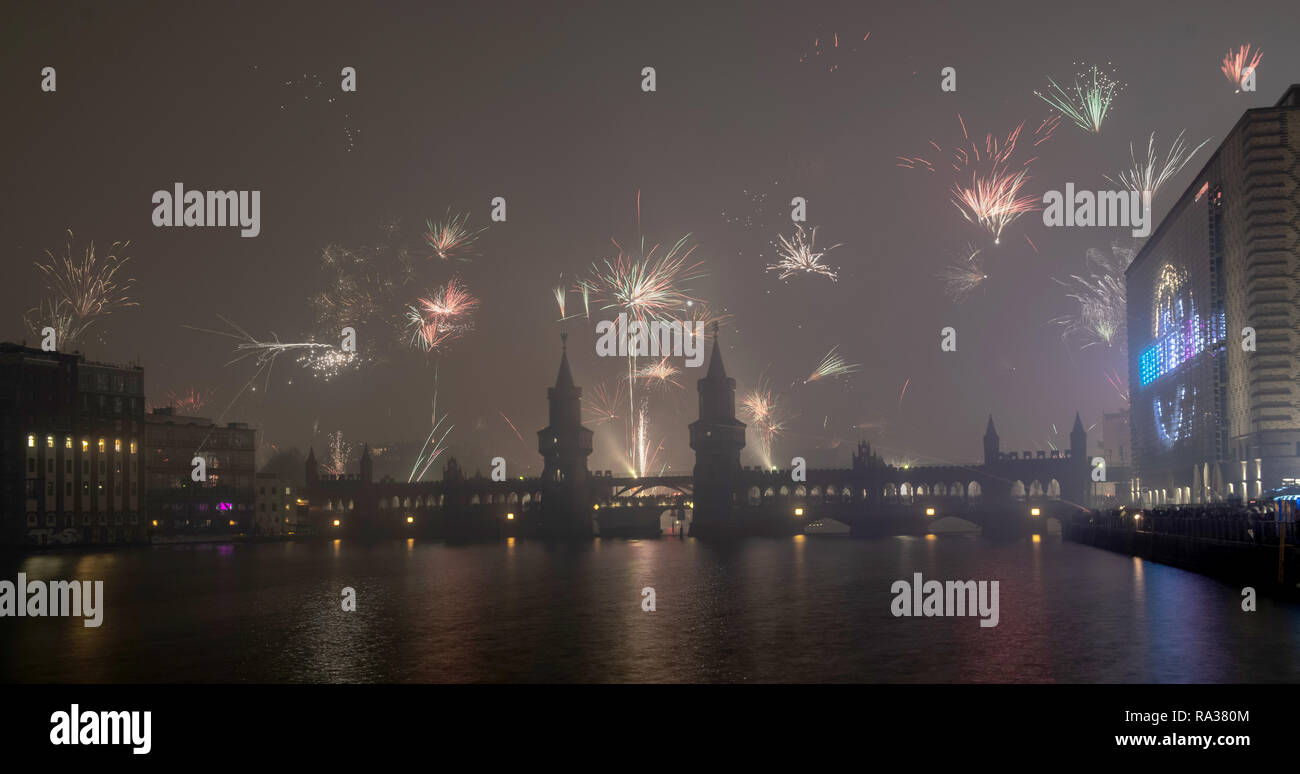 Berlin, Germany  01st Jan, 2019  Rockets go up into the sky behind
