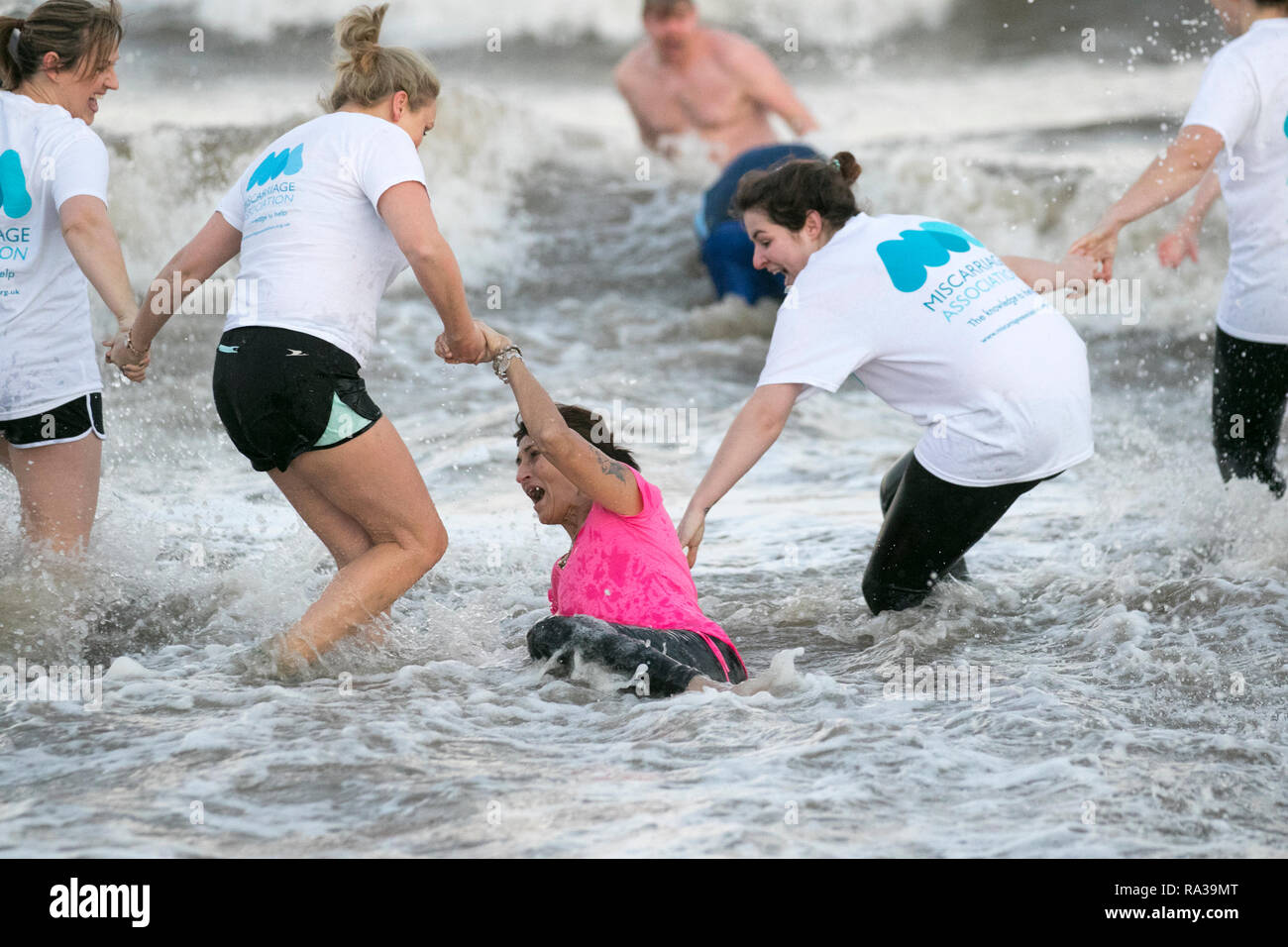 Fleetwood, Lancashire, UK. 1st Jan 2019. Pregnant mums New Year's Day Swim. Organised by Fleetwood Kite Club, the New Year's Day Dip is a fairly new tradition in Fleetwood. It started in the 1990's and is growing every year.  There are no rules other than no wetsuits allowed. There's no minimum time of how long you have to stay in the sea for – other than you have to get wet!  Credit: MediaWorldImages/AlamyLiveNews. - Stock Image