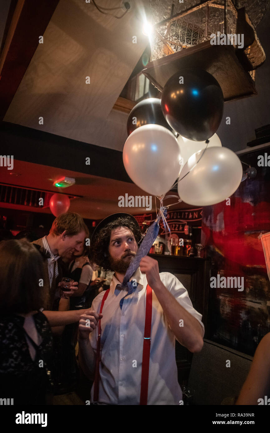 Oxford, UK. 31st Dec, 2018. New Year's Eve party in Oxford. The Rickety Press through a celebration of the 1920s, complete with blacked out windows and a performance by the Rabbit Foot Spasm band. Albie, on the dance floor with balloons. Credit: Sidney Bruere/Alamy Live News Stock Photo