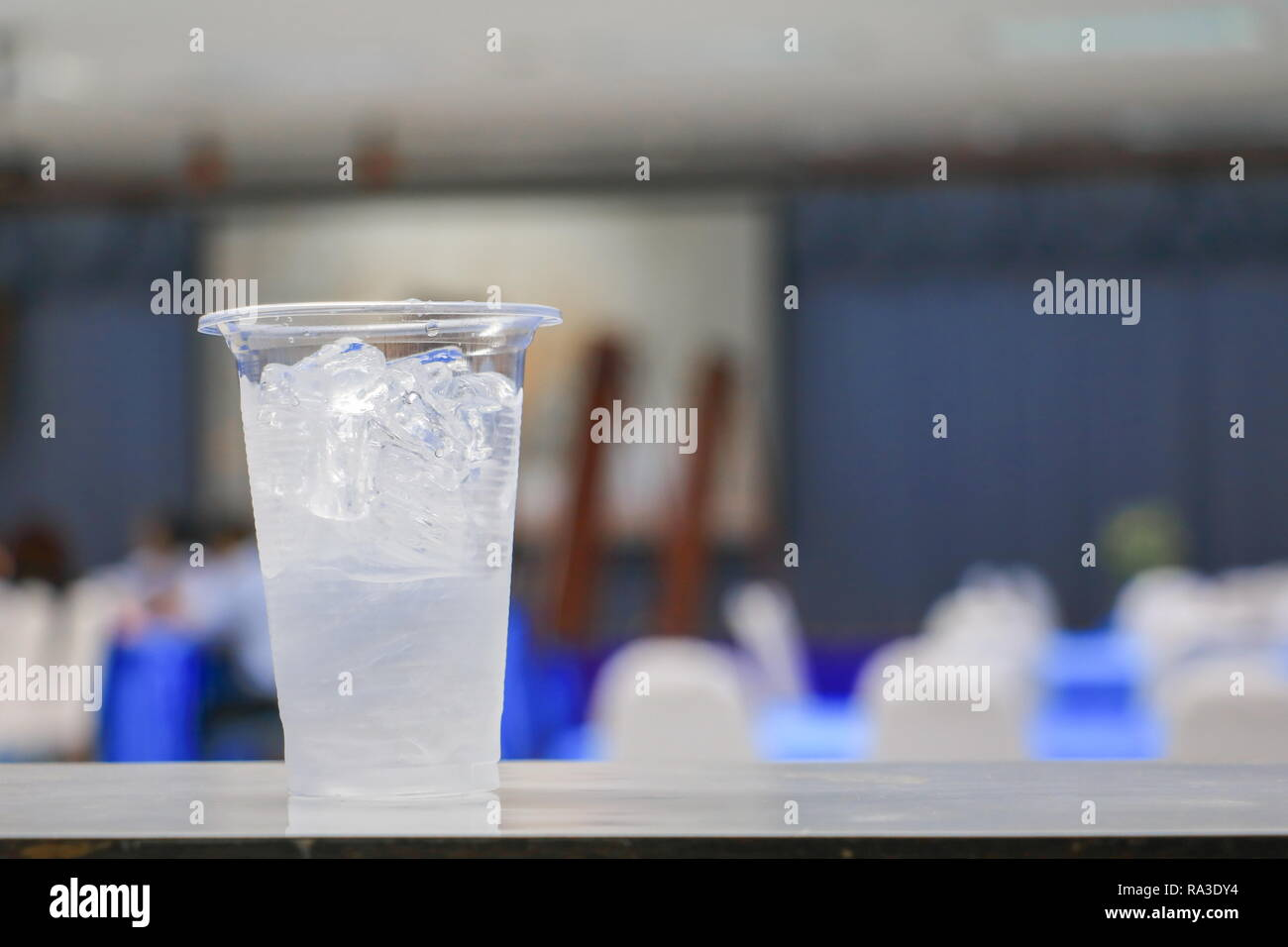 ice water in glass-plastic in seminar conference room