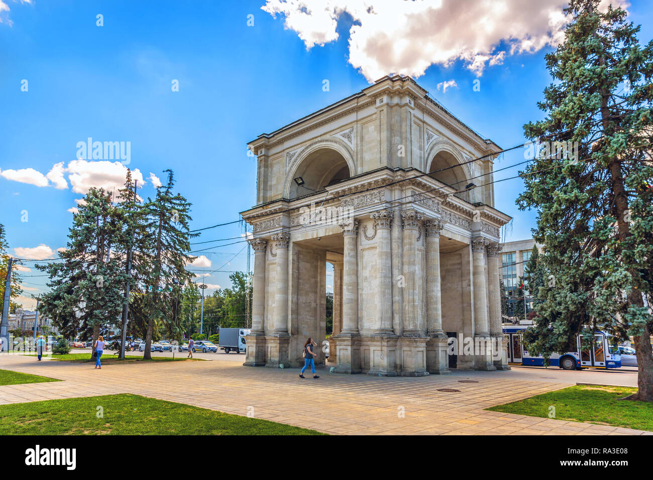 Chisinau, Moldavia - July 4th 2018 - Locals walking near by a huge arch in the downtown of Chisinau in Moldavia - Stock Image
