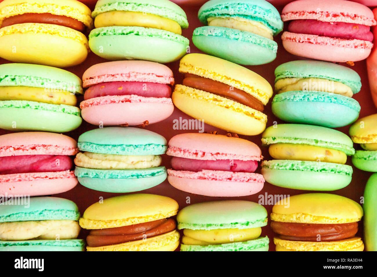 Sweet Almond Colorful Pink Blue Yellow Green Macaron Or Macaroon Dessert Cake Background French Sweet Cookie Minimal Food Bakery Concept Flat La Stock Photo Alamy