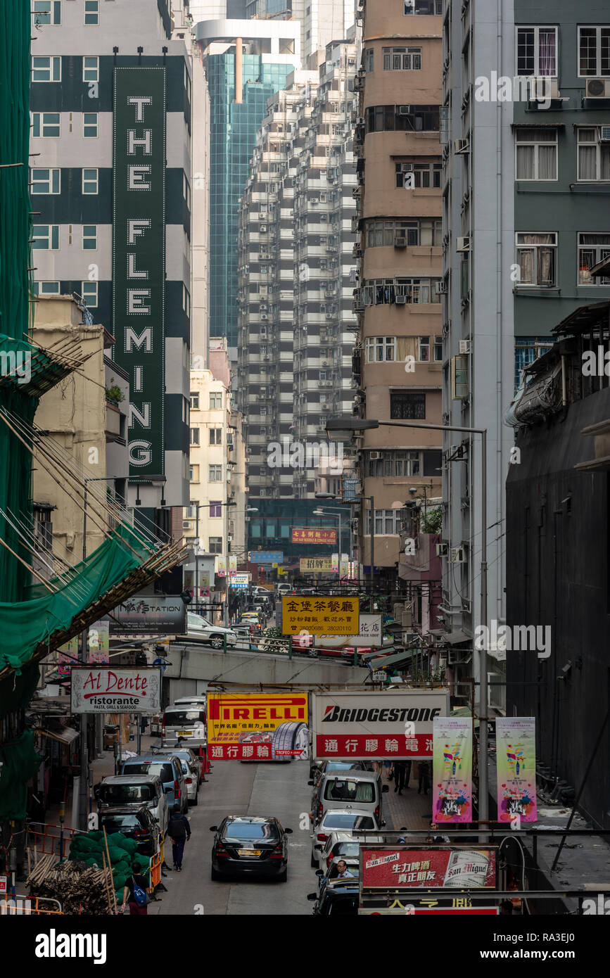 The Fleming Hotel stands proudly above the advertising hoardings and bamboo scaffolding of Jaffe Road in bustling Wan Chai, Hong Kong. - Stock Image