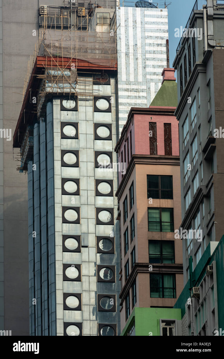 Wildly contrasting styles are a feature of the apartment and office blocks that line Hong Kong's Lockhart Road in Wan Chai - Stock Image