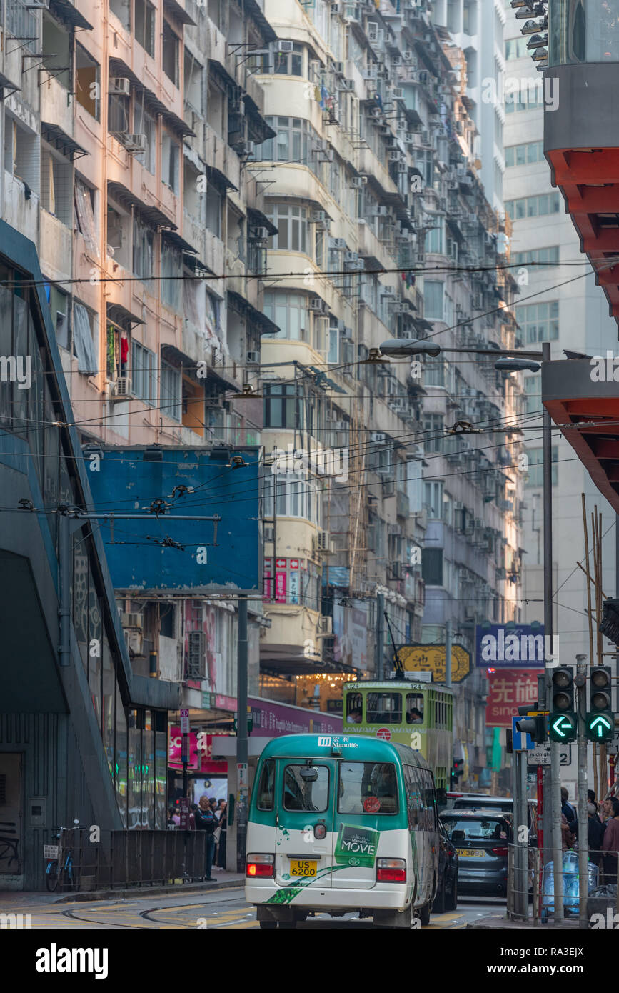 Bustling Percival Street in Hong Kong's Causeway Bay funnels trams, buses and people towards Leighton Road - Stock Image