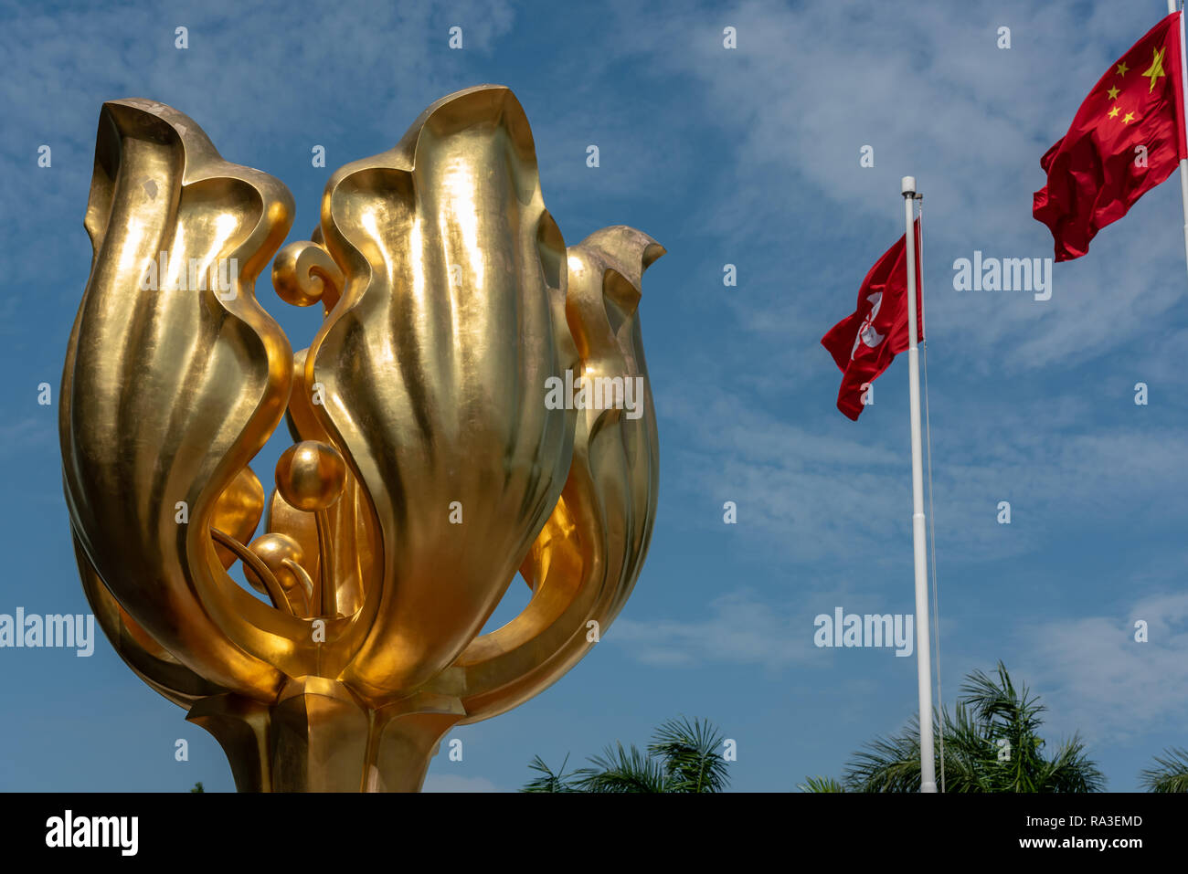 The 'Forever Blooming Golden Bauhinia Sculpture' which lends its name to Golden Bauhinia Square at Hong Kong's Convention and Exhibition Centre - Stock Image