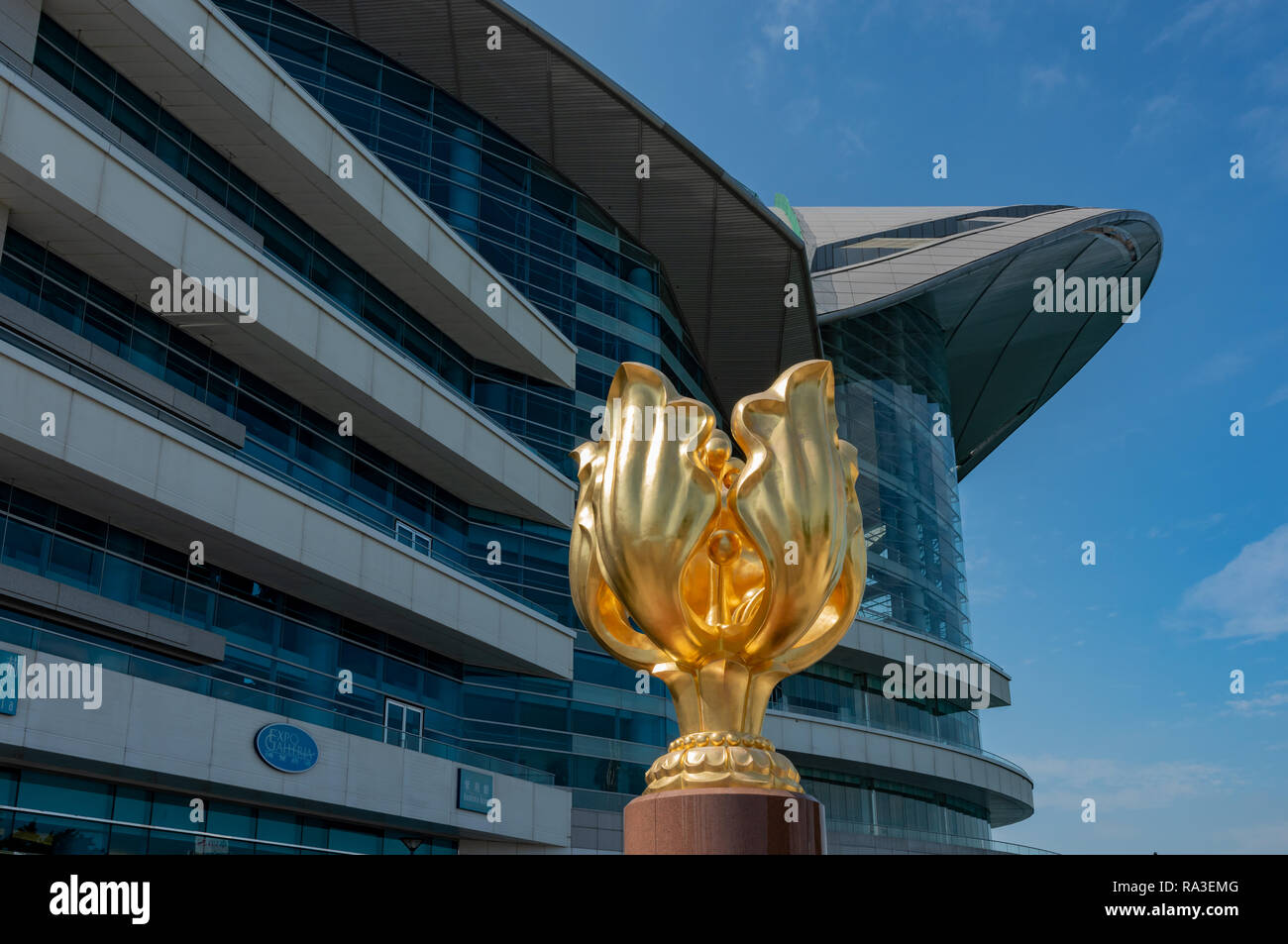The Golden Bauhinia statue in front of the Hong Kong Convention and Exhibition Centre - Stock Image