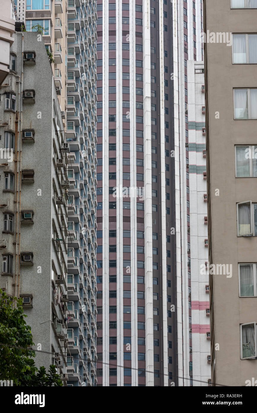 Skyscrapers appear to crowd out the people and traffic in Wan Chai's Amoy Street. - Stock Image