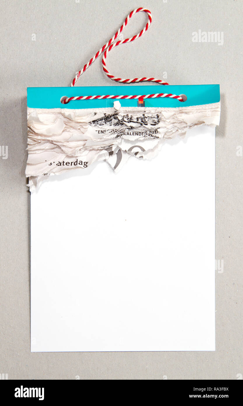 Tear calendar with all pages gone on a grey background - Stock Image