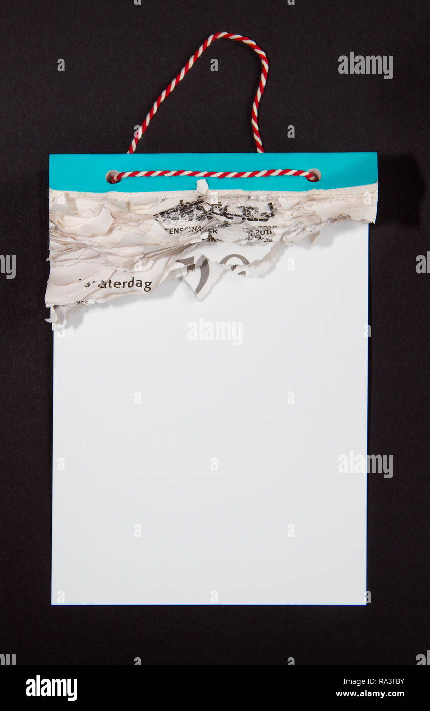 Tear calendar with all pages gone on a black background - Stock Image