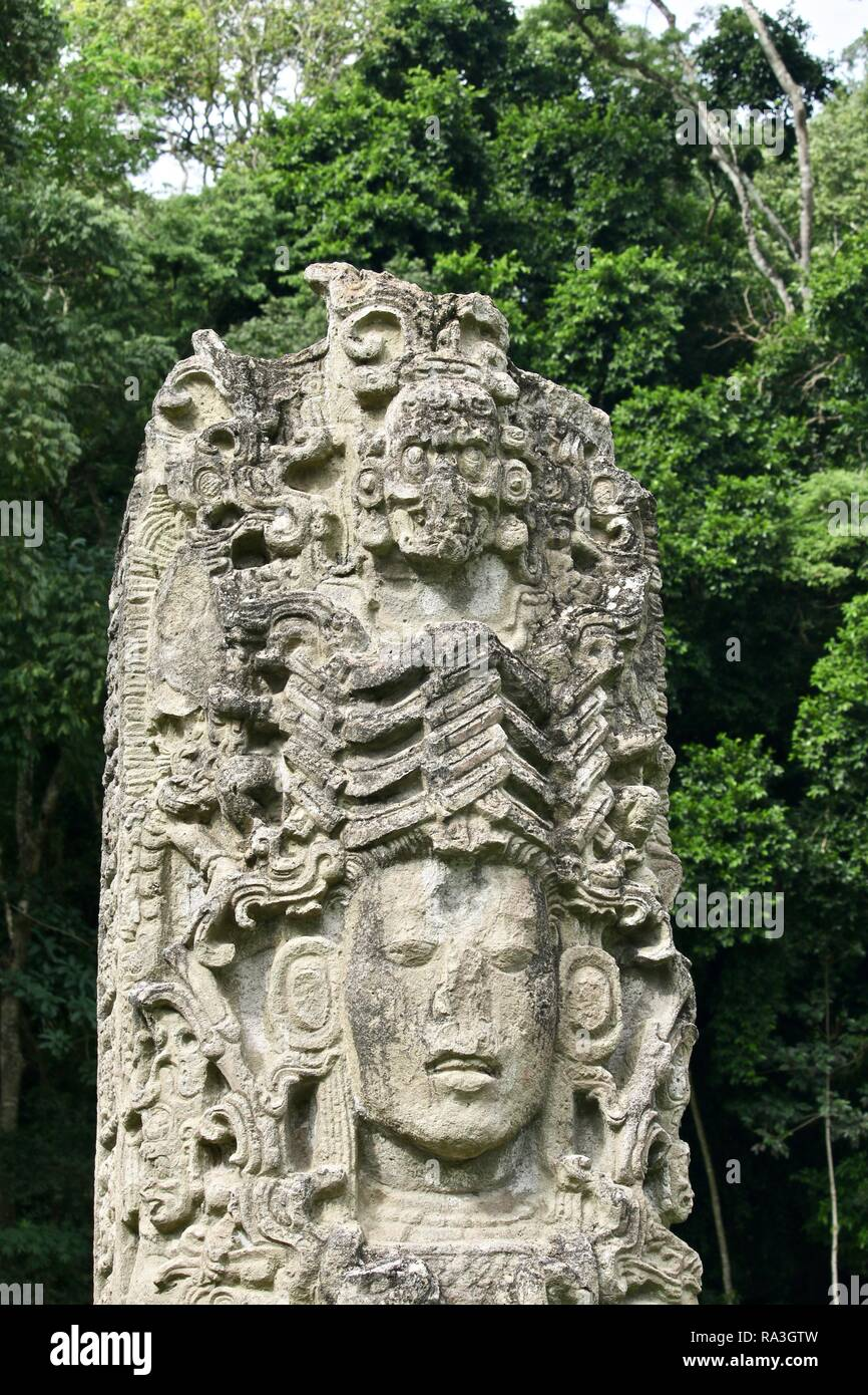 Carved stone pillars in Mayan ruins in the jungles of Honduras - Stock Image