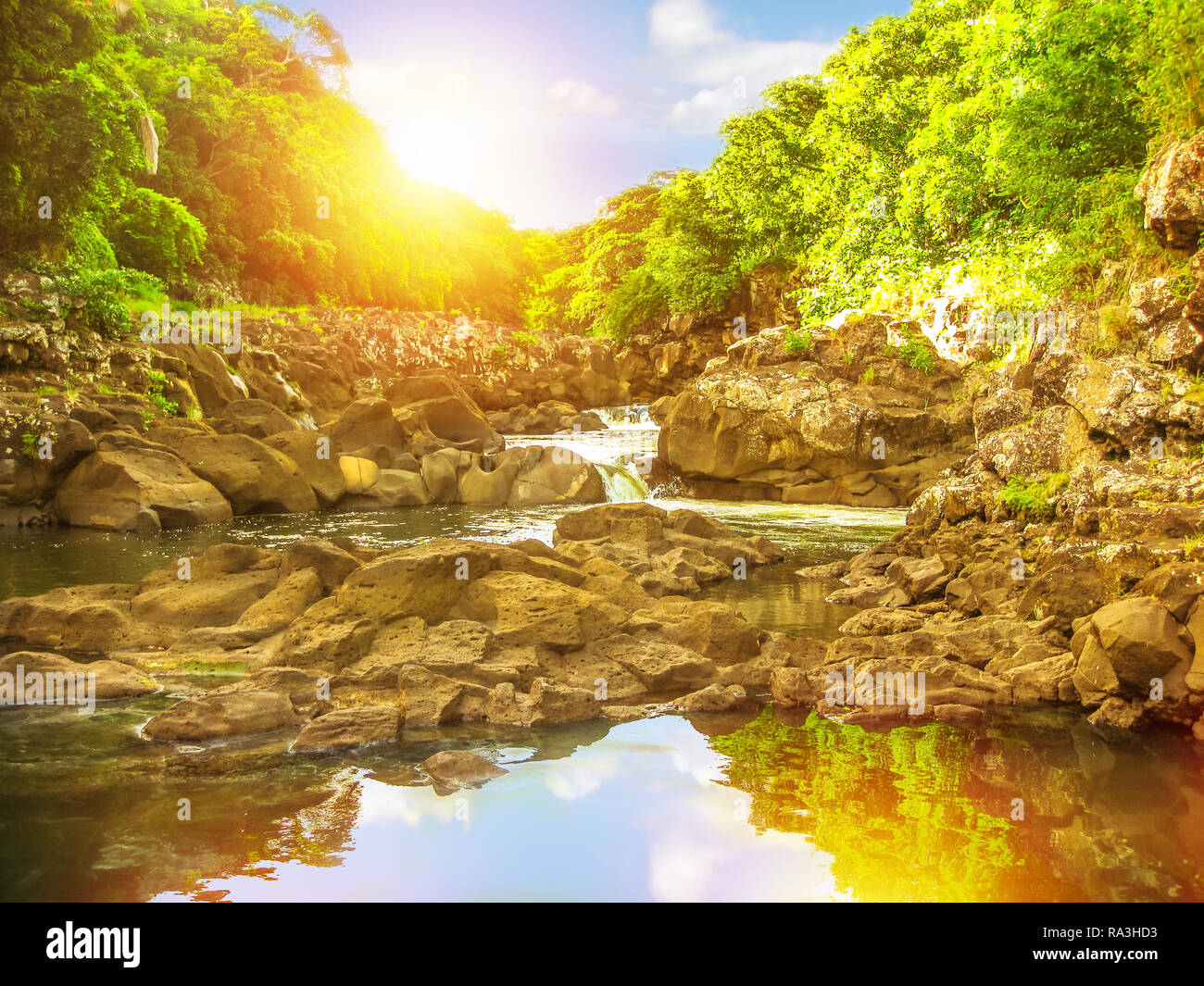 Black River Gorges National Park at sunset light, the largest protected forest of Mauritius, Indian Ocean, Africa. Scenic landscape reflected in the waters of popular travel destination. - Stock Image