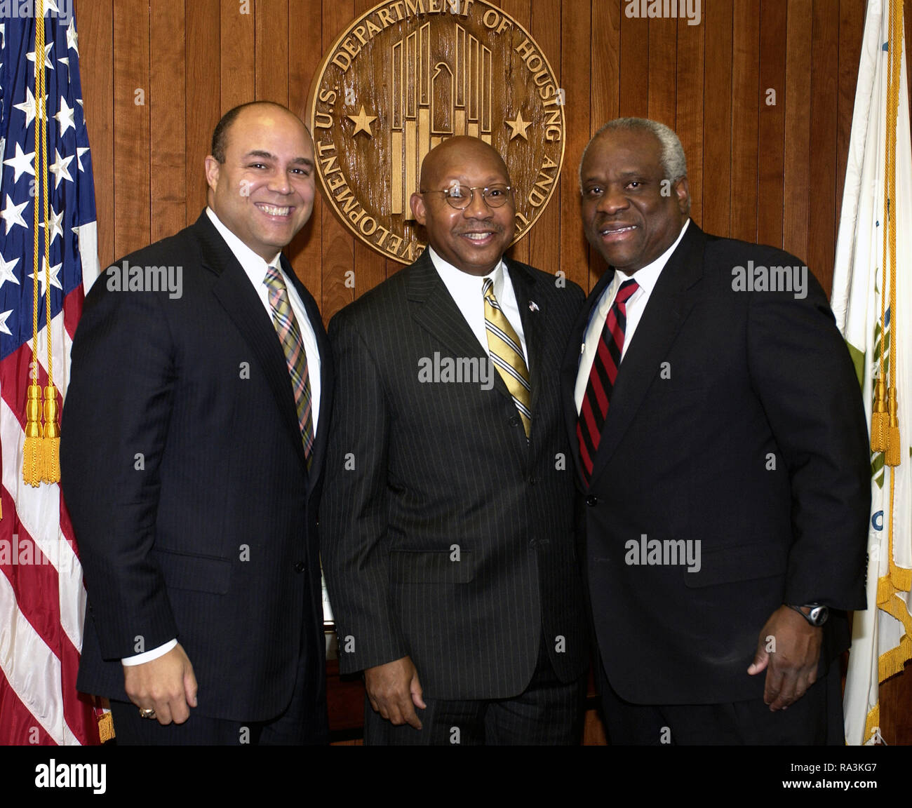 Secretary Alphonso Jackson, [center], with former Federal Communications Commission Chairman Michael Powell, [left], and U.S. Supreme Court Justice Clarence Thomas, [right], at HUD Headquarters. Stock Photo