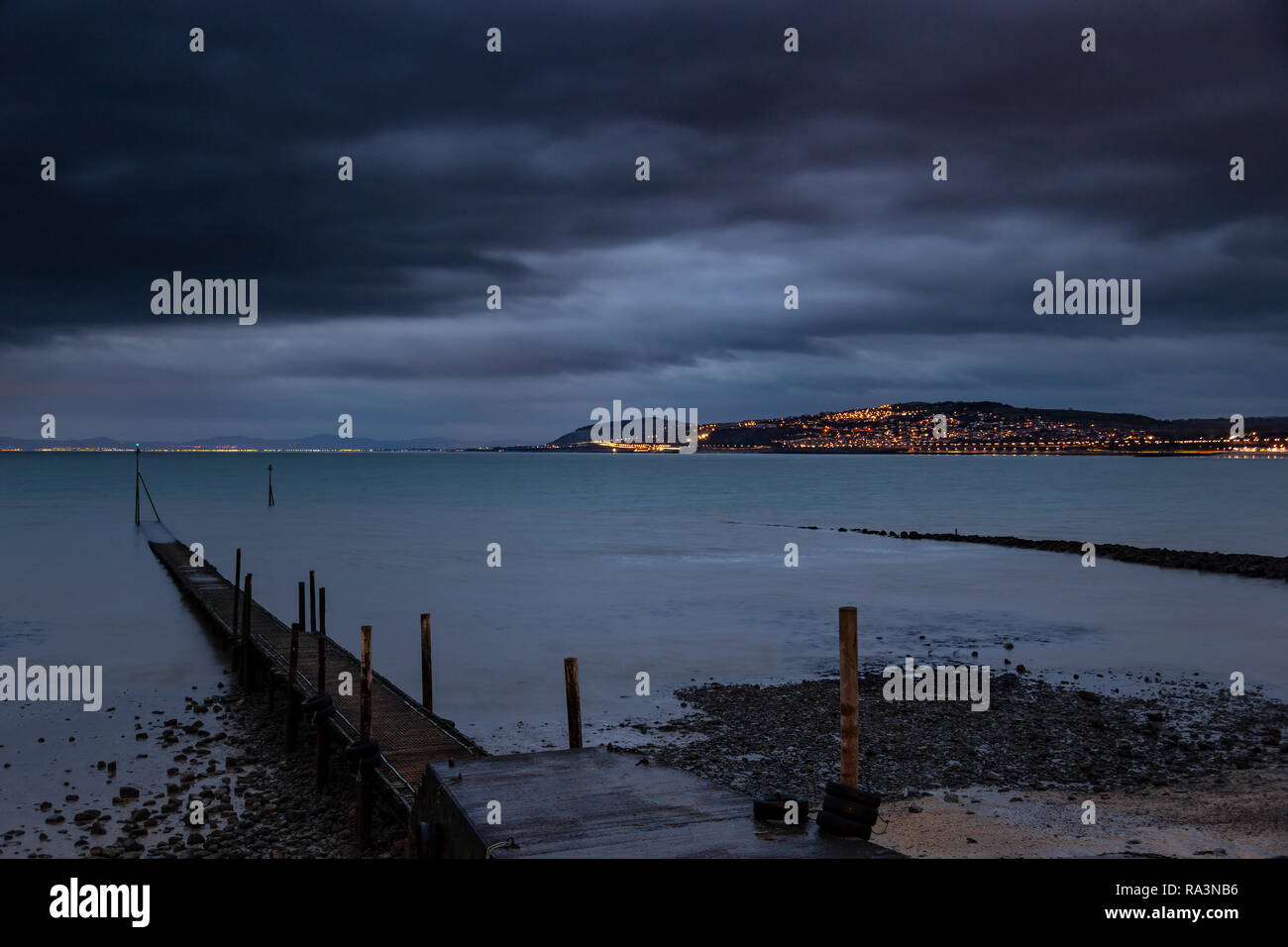Jetty at Rhos-on-Sea at night on the North Wales coast Stock Photo