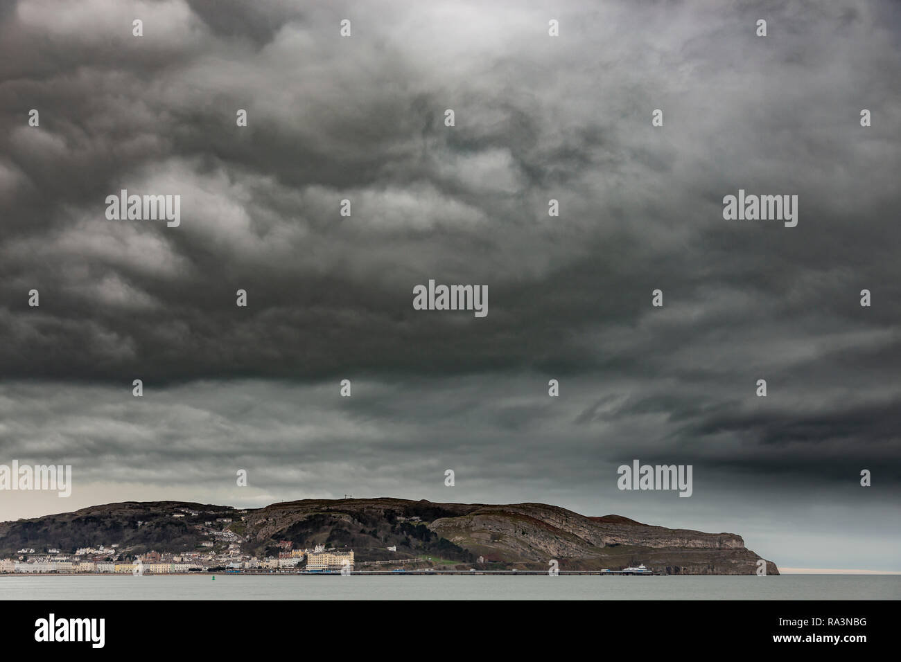 Storm clouds over the Great Orme at Llandudno on the North Wales coast Stock Photo