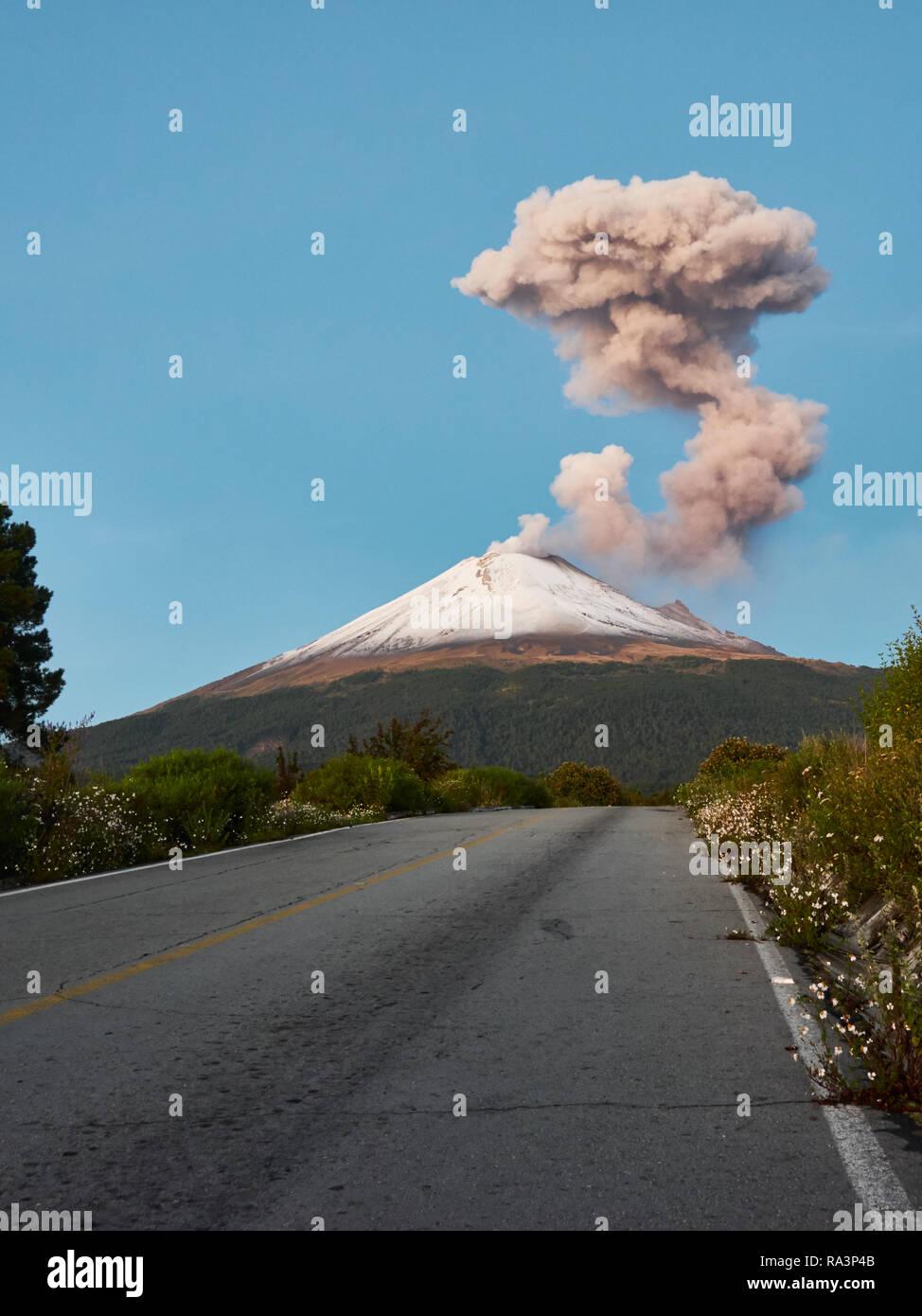 Fumaroles on Popocatepetl volcano seen from the street Ruta de Evacuacion at morning - Stock Image