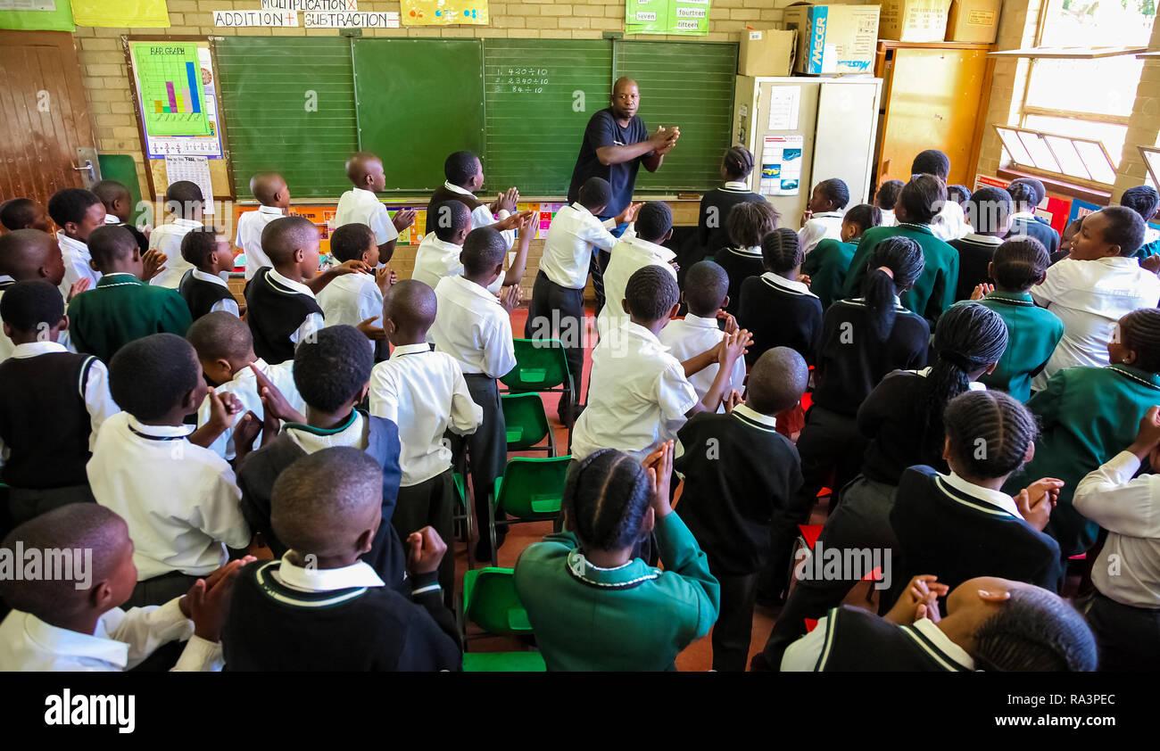 Child Raising Hand In Classroom Stock Photos Child Raising Hand In