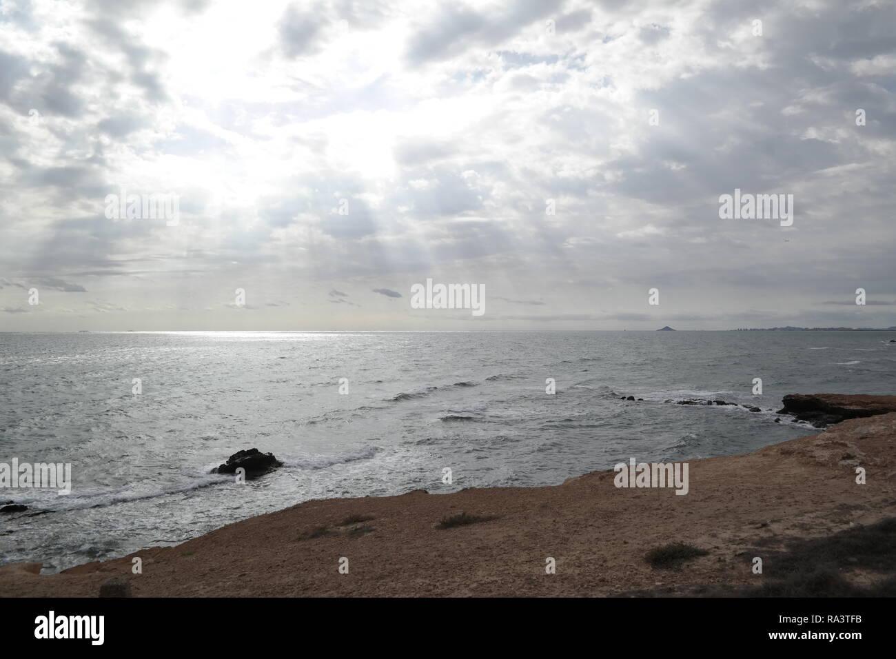 Sunbeams over the sea - Stock Image
