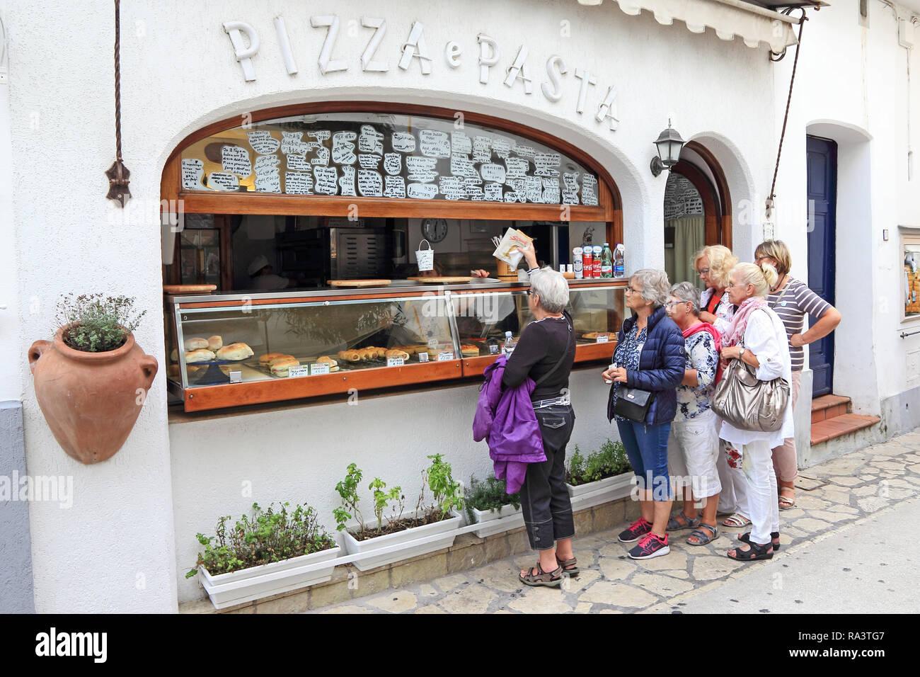 Customers queueing at food takeaway, Capri Stock Photo
