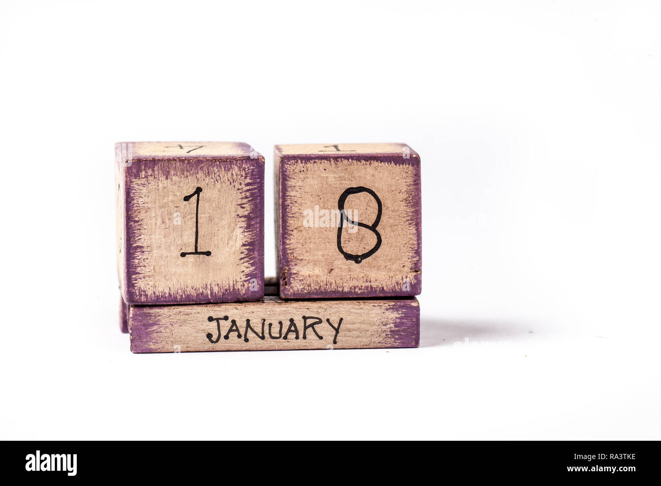 Colorful Wooden Block Perpetual Calendar Showing January 18th - Stock Image