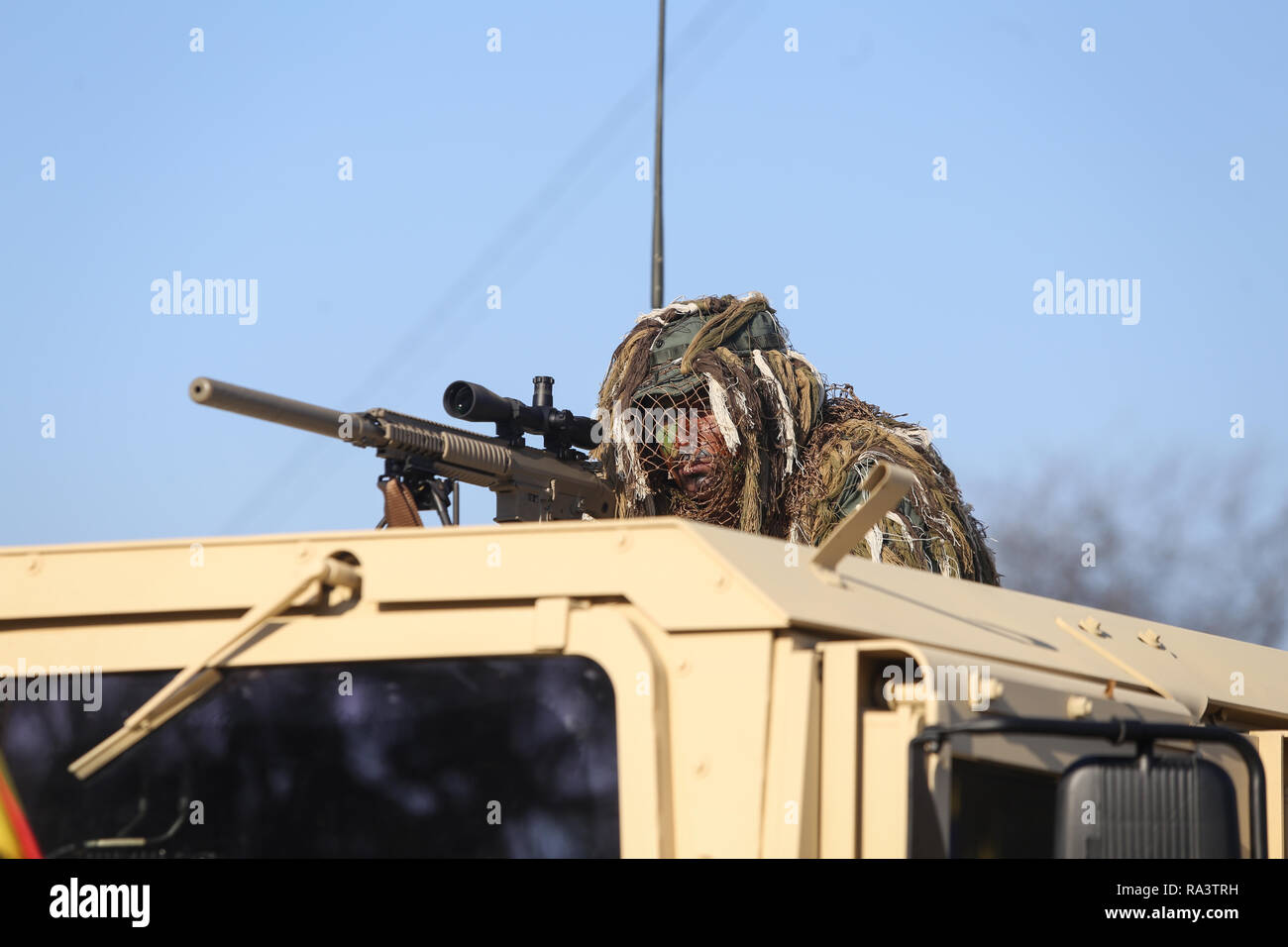Bucharest, Romania - December 1, 2018: Romanian army sniper, armed with the US M110 semi-automatic sniper rifle and on top of a Humvee armored vehicle Stock Photo