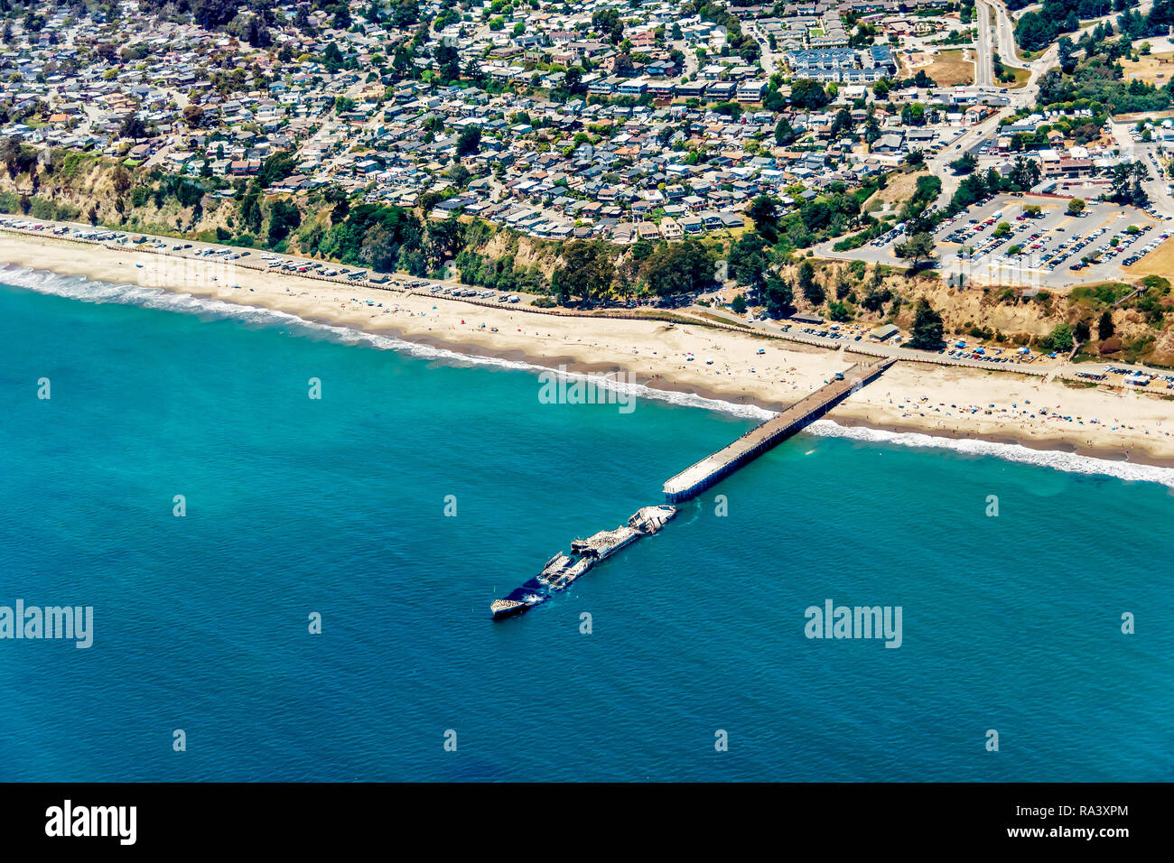Aerial view of a sunken ship at the end of the pier in Aptos, California. - Stock Image