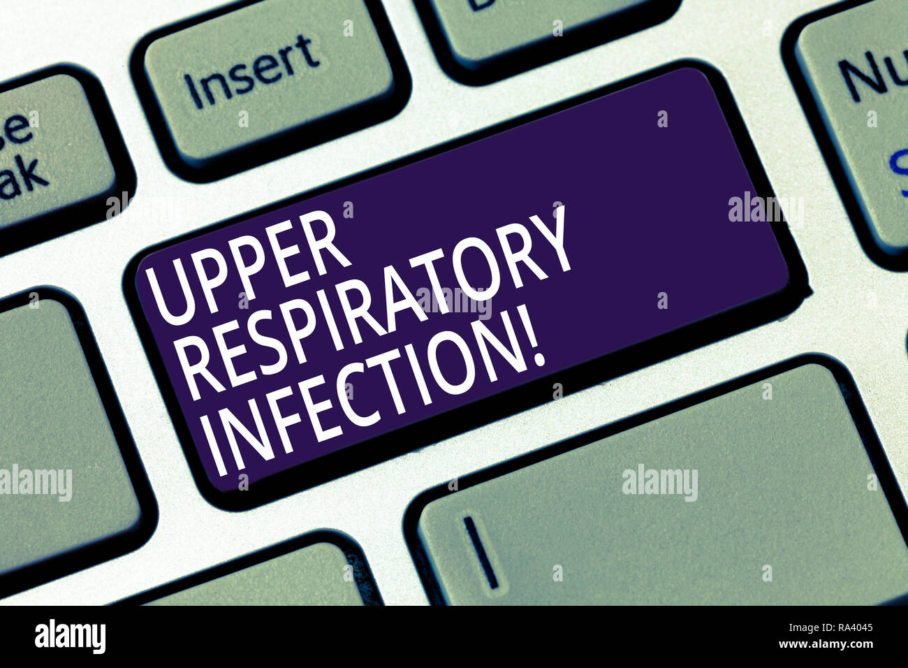 Word writing text Upper Respiratory Infection. Business concept for illnesses caused by an acute infection Keyboard key Intention to create computer m - Stock Image