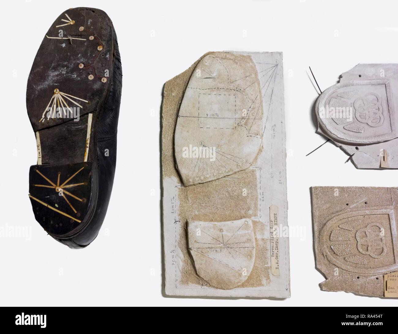 Plaster cast of shoe sole tread from criminal's shoes taken at crime scene for criminal investigation - Stock Image