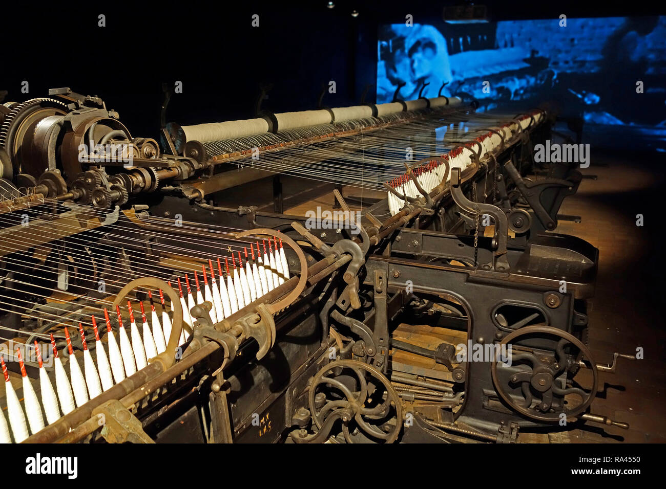 24 meter long selfactor, self-acting spinning mule at MIAT / Industriemuseum, industrial archaeology museum, Ghent, Belgium Stock Photo