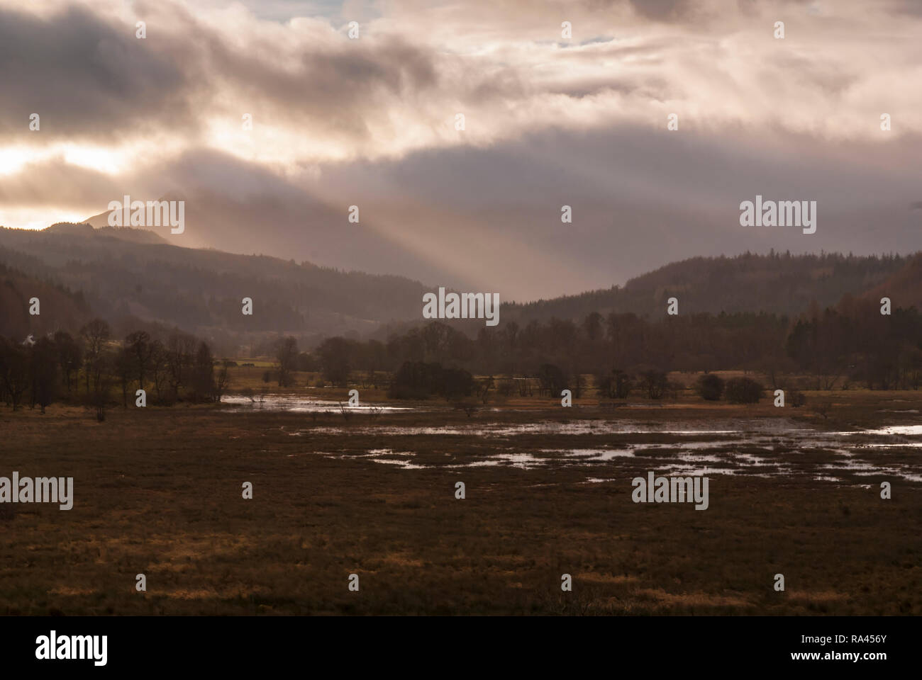 A miserable day overlooking the River Balvag and flooded fields near Balquhidder in Stirling, Scotland. 22 December 2008 Stock Photo
