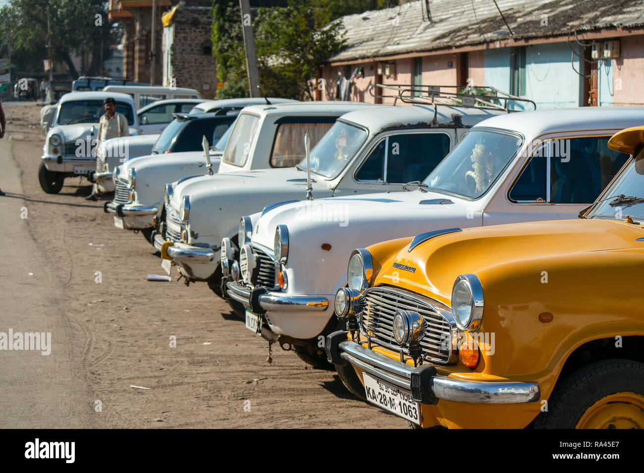 A line of parked so called 'King of India' Ambassador Taxi's from the Hindustan Motor company. - Stock Image