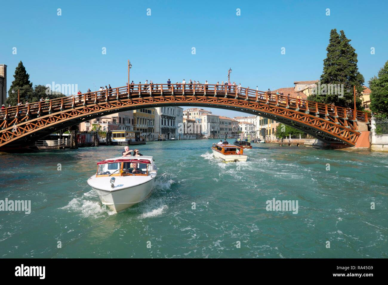 Accademia Bridge, Ponte Accademia, Motorboats in Canal Grande, Venice, Veneto, Italy - Stock Image