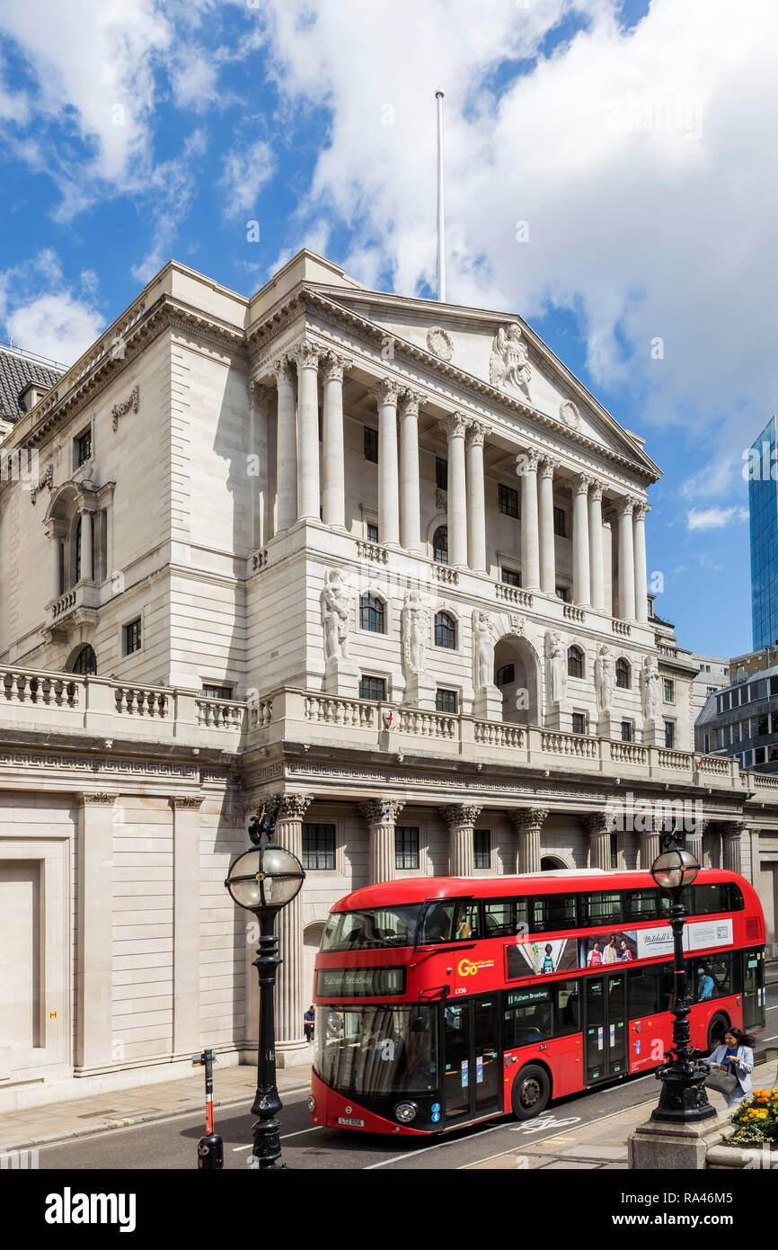 Red bus in front of Bank of England, financial district, London, Great Britain - Stock Image