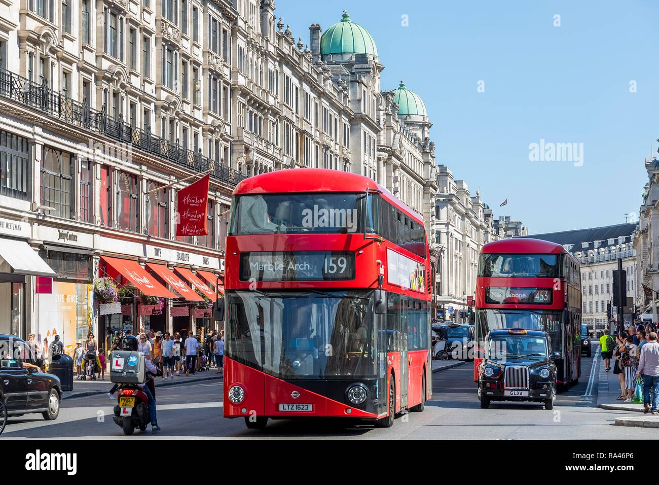 Red double-decker buses in the shopping street Regent Street, London, Great Britain - Stock Image