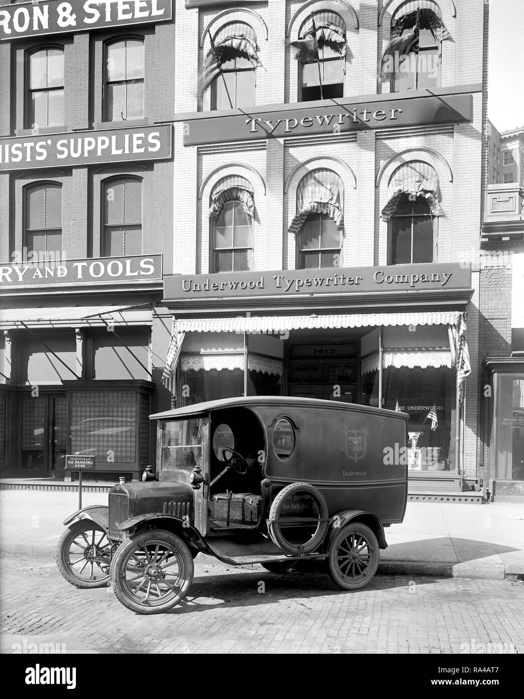 Underwood Typewriter Company exterior with truck parked outside in street  ca. early 1900s - Stock Image