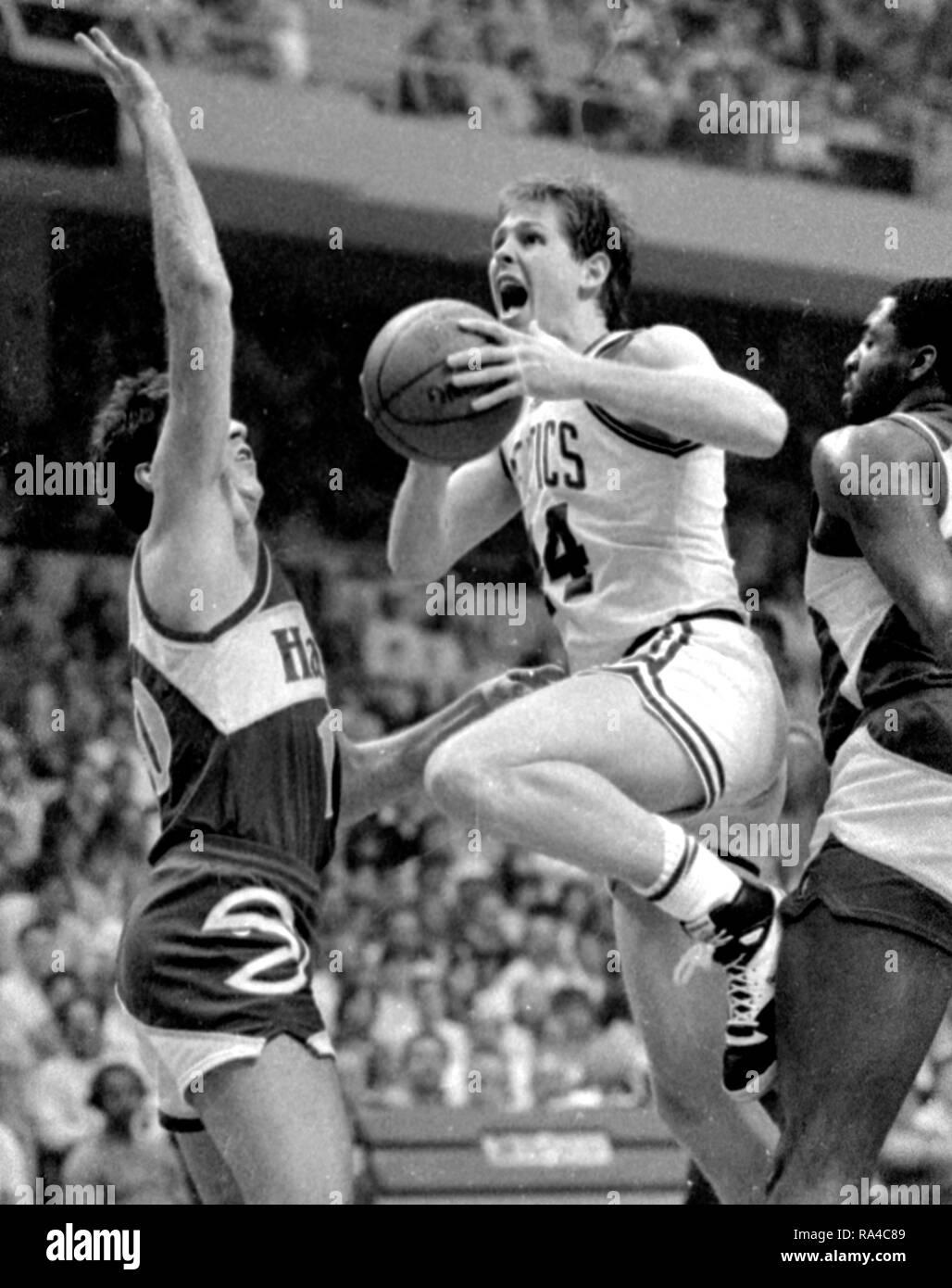Boston Celtics Danny Ainge scores past Atlanta Hawks in game action at the Boston Garden in the 1986 season Photo by Bill Belknap - Stock Image